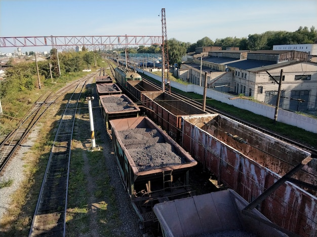 Railway. freight wagons carrying different loads. heavy industry concept
