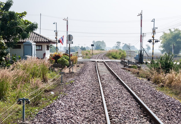 Railway intersection with the automatic barrier.
