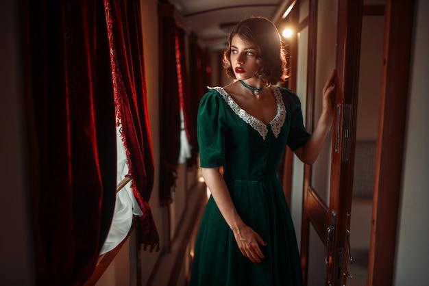 Railway journey, woman in retro train, rich interior. old wagon. railroad voyage