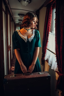 Railway journey woman in vintage train compartment