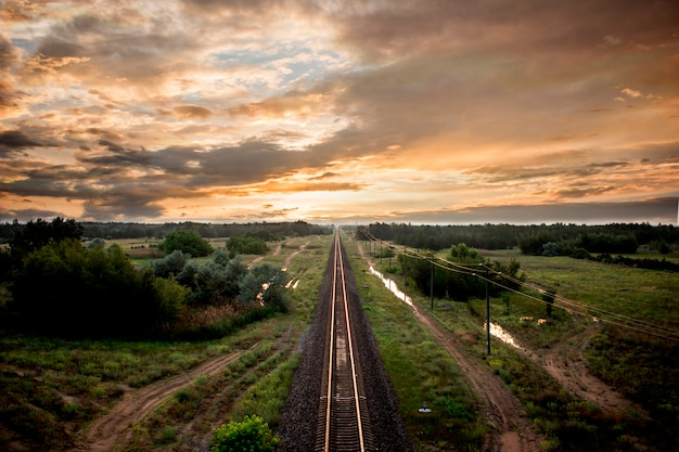 Railway nature landscape orange sunset on the sky. ukraine city kherson