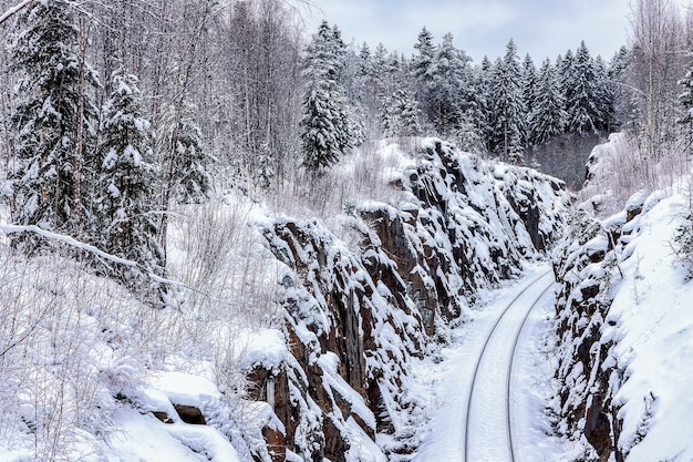 The railway passes in a hollow cut in the rock republic of karelia russia