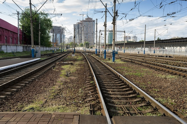 Railway in a residential area of the city among near high-rise buildings on a sunny day
