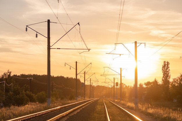 Railway at sunset without train. beautiful perspective view to railroad.