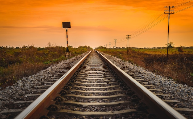 Railway track in a rural scene at sunrise time