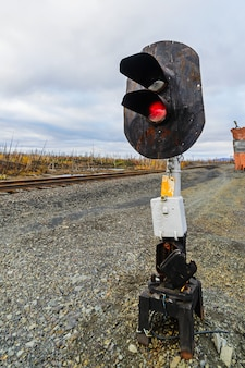Railway traffic semaphore. railway station in autumn tundra.