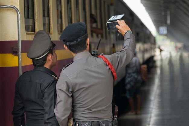 Railway train on the railroad tracks in bangkok station