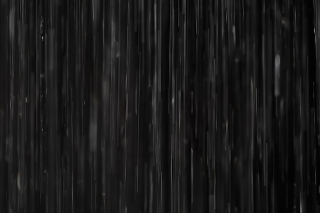 Rain on black. abstract background.