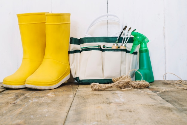 Rain boots and gardening tools