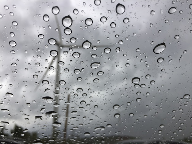 Rain on the car glass outside is a windmill view. sad and lonely background