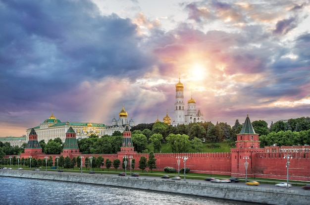 Rain clouds over the towers and domes of the moscow kremlin and the sun's rays