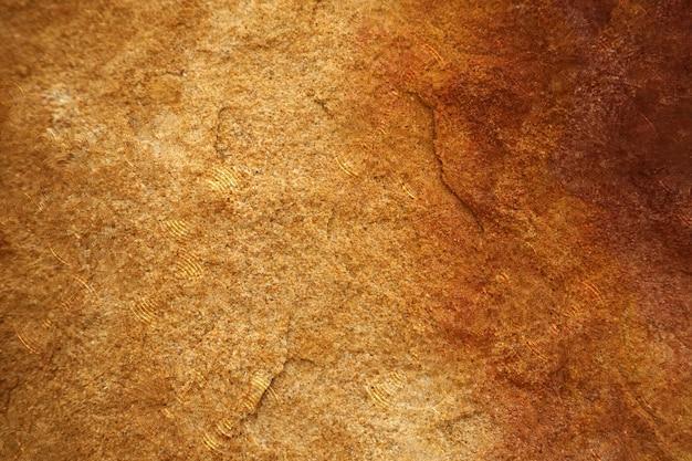 水と内部の壁紙の背景のための洞窟の重いハード花崗岩の石の表面に雨滴