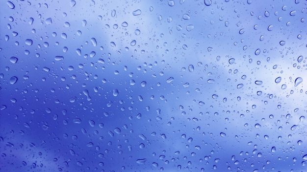 Rain drops on the glass, background.