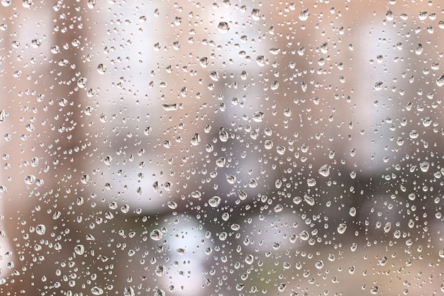 Rain drops on the window glass background