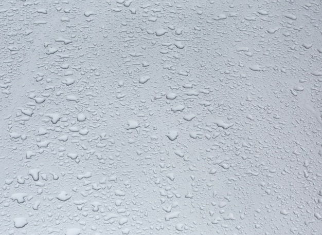Rain water drops texture on a glass surface
