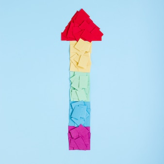 Rainbow arrow made of colorful papers