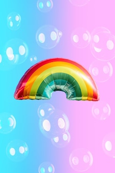 Rainbow balloon on blue and pink background and soap bubbles. concept of lgbti. copy space.