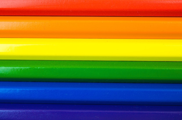 Rainbow color lgbt pride flag, symbol of sexual minorities and tolerance, flat lay composition photo with color pencils