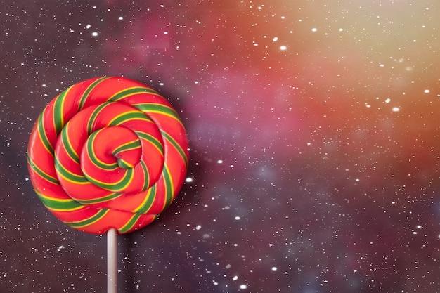 Rainbow color lollipop hard caramel on the space . copyspace. top view.