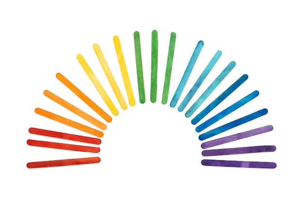 Rainbow color wooden ice cream sticks on white. multicolored abstract arc