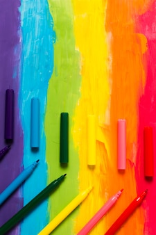 Rainbow colored background with markers