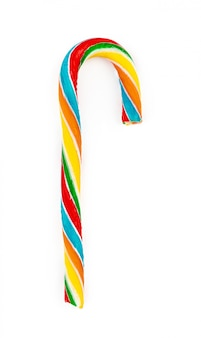 Rainbow colored candy cane isolated on white