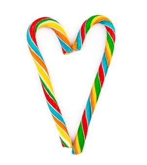Rainbow colored candy cane isolated