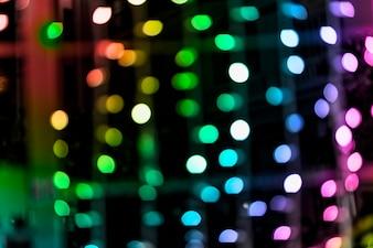 Радуга цвета сверкающих блеск лампы фон огни
