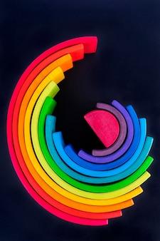 Rainbow colored wood. rainbow shape educational toy set