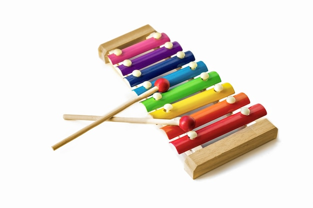 Rainbow colored wooden toy 8 tone xylophone glockenspiel isolated on white background. toy glockenspiel. music, vibrant. rhythm, listen.