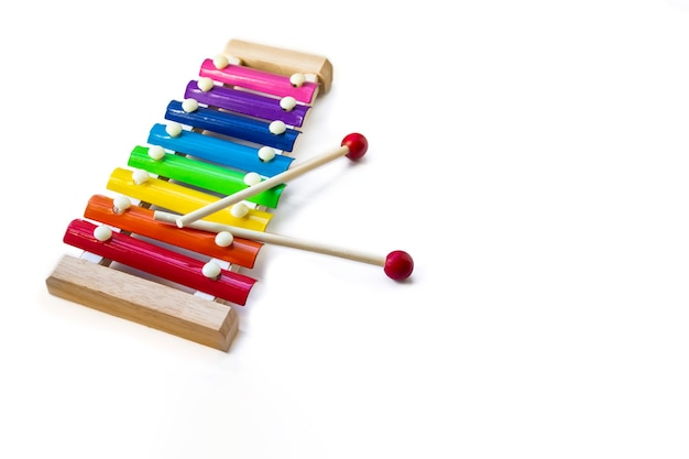 Rainbow colored wooden toy 8 tone xylophone glockenspiel isolated on white background with clipping path. copyspace.