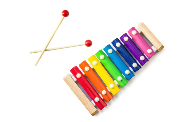 Rainbow colored wooden toy 8 tone xylophone glockenspiel isolated on white background with clipping path. toy glockenspiel made of metal and wood. music, vibrant. rhythm, listen. copyspace.
