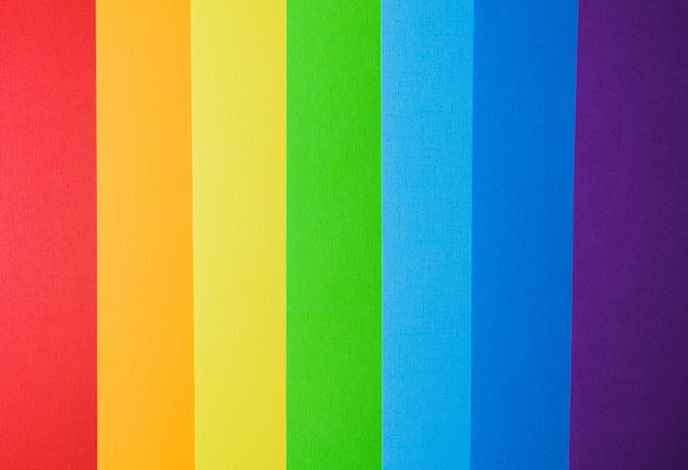 Rainbow colors creative paper background, view from above