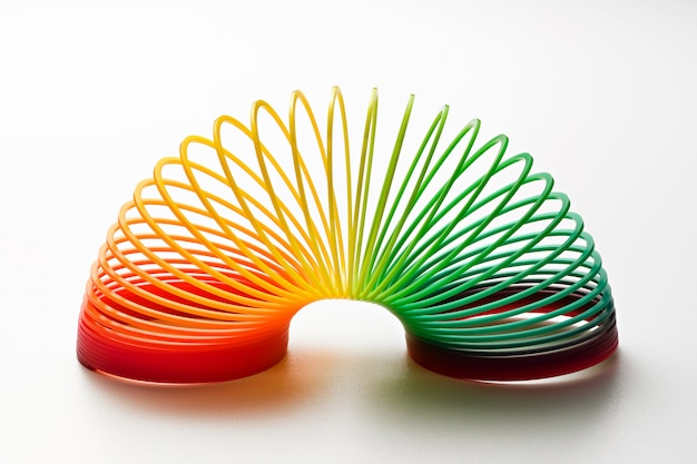 Rainbow coloured slinky toy