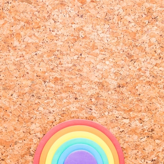 Rainbow eraser placed in bottom of pin board