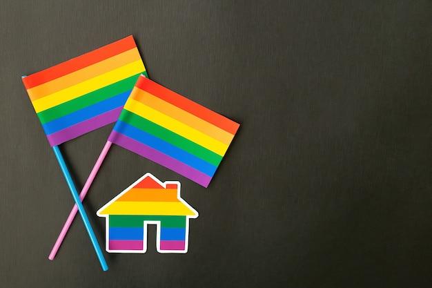 The rainbow flag and house, lgbt symbol on an black background