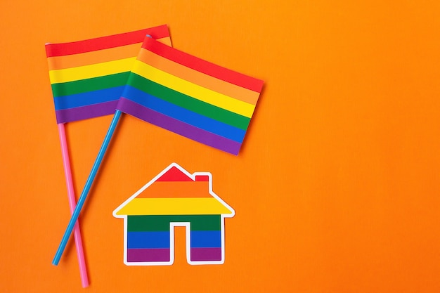 The rainbow flag and house, lgbt symbol on an orange background