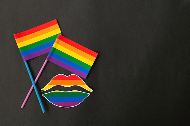 The rainbow flag and lips on an black background