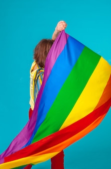 Rainbow flag. woman holding and waving large lgbt flag
