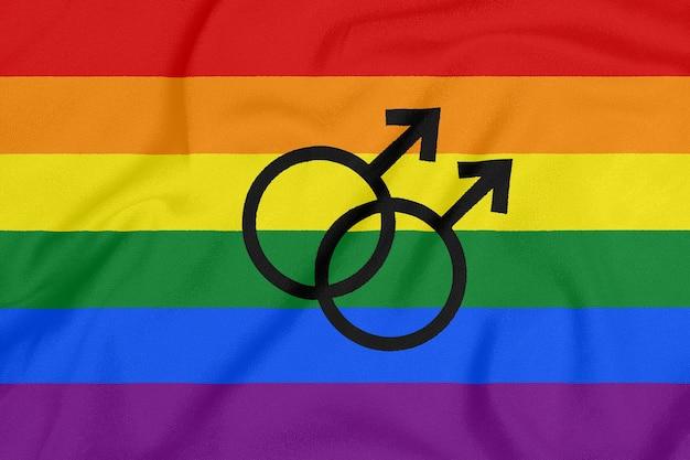 Rainbow gay pride flag on a textured fabric. lgbt community. pride symbol