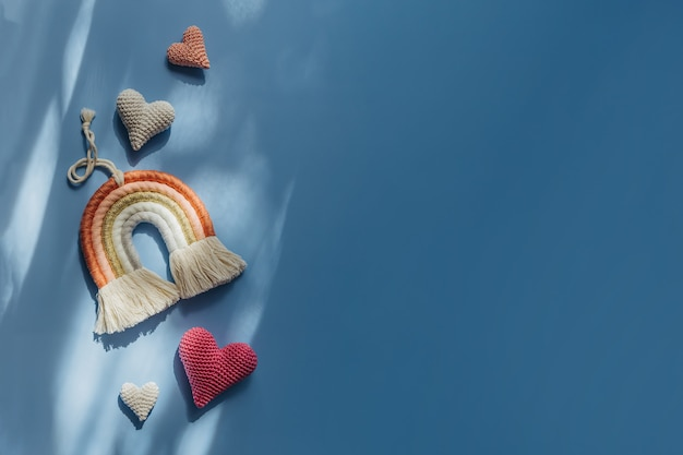 Rainbow and hearts on blue background. cute decoration and accessories for baby and children's room. flat lay, top view