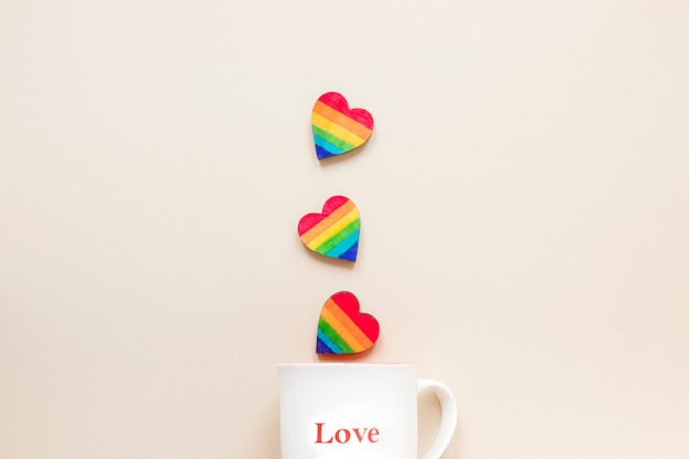 Rainbow hearts with cup with love inscription