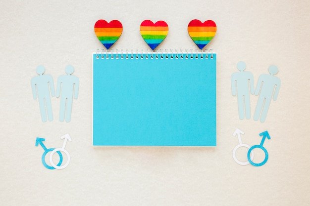Rainbow hearts with gay couples icons and notepad