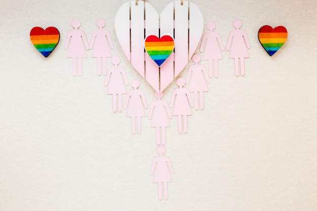 Rainbow hearts with lesbian couples icons on table