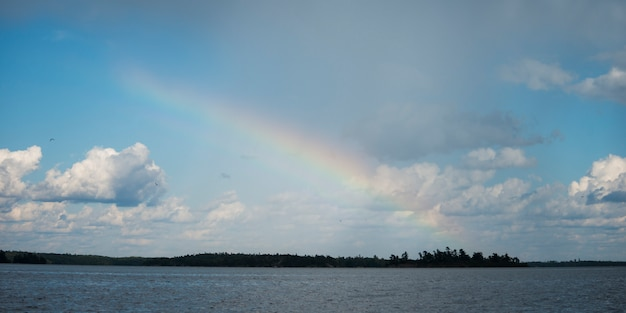 Rainbow over a lake, lake of the woods, ontario, canada