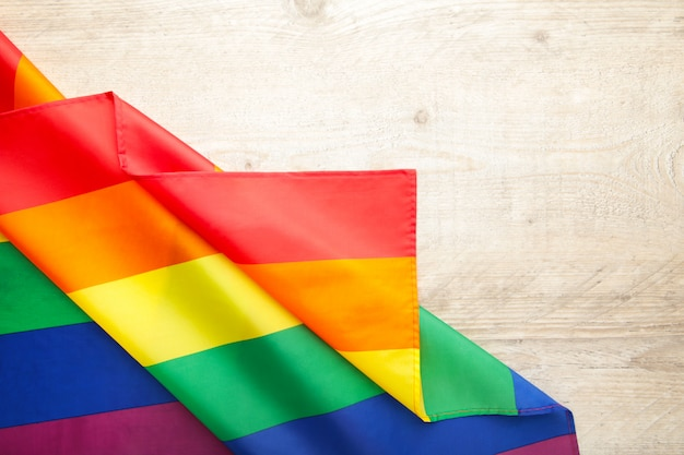 Rainbow lgbt flag on light background with copy space