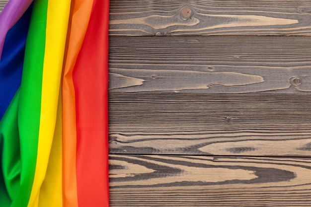 Rainbow lgbt flag on wooden table background