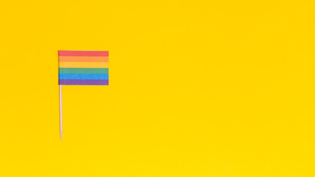 Rainbow lgbt flag on yellow background