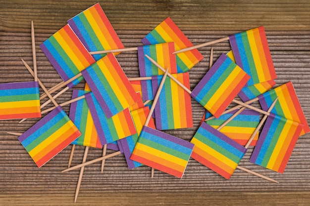Rainbow lgbt flags mixed on wooden background