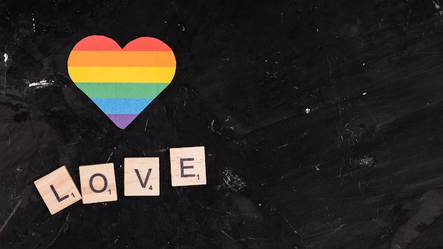 Rainbow lgbt heart with love sign on black space background